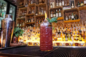 A picture of our rum runner cocktail with fire and mint