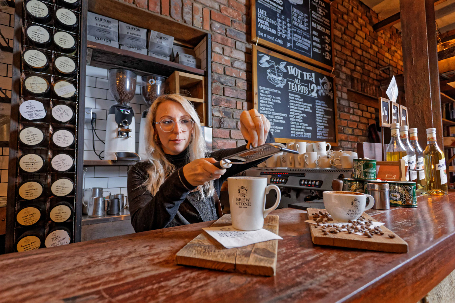 A picture of our barista Becky making hot chocolate and coffee at BrewStone bar and restaurant