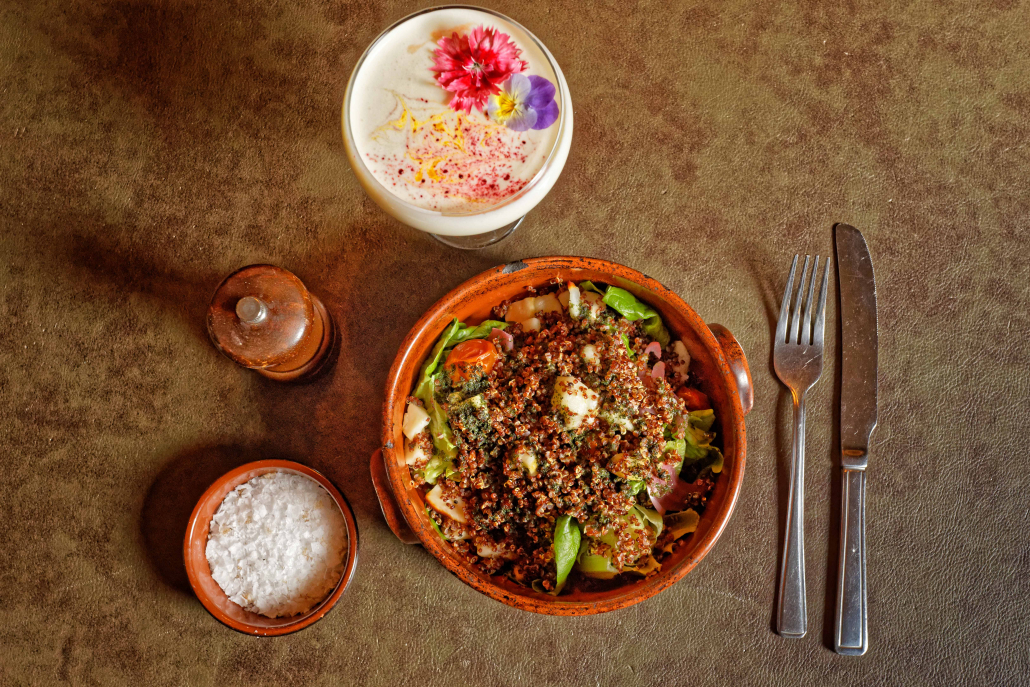 A picture of our quinoa salad with a solero cocktail on the side