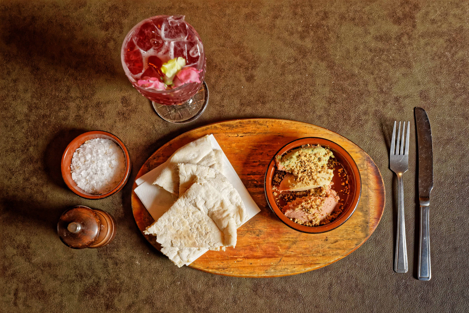 A picture of our hummus and flatbread side with a soft drink